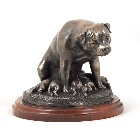 Rotweiler statue on wooden base