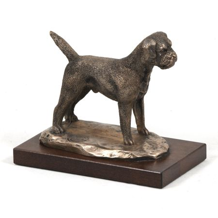 Border Terrier statue on wooden base