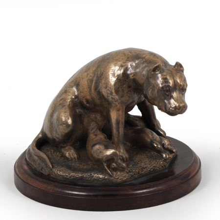 American Staffordshire Terrier statue on wooden base