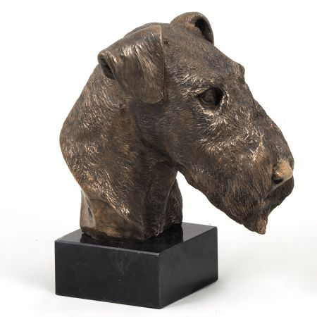 Airedale Terrier statue on marble base