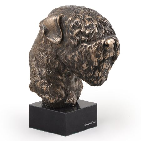 Black Russian Terrier statue on marble base